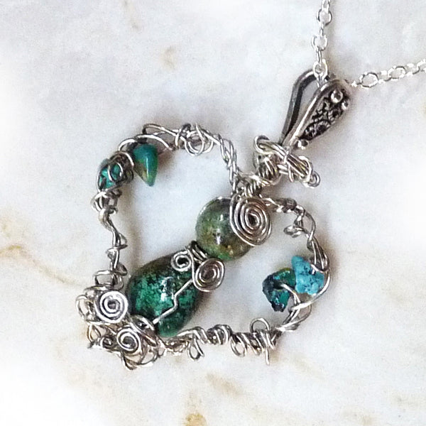 heart shaped turquoise angel in antiqued silver wire wrap