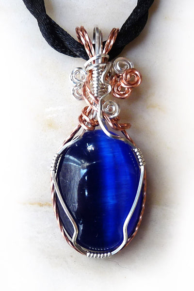 dark blue swirls cats eye wire wrapped pendant necklace