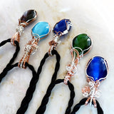 Tops of colorful cats eye silver & copper necklaces