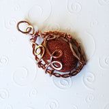 handmade copper looped pendant & shiny brown goldstone