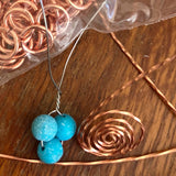 Artist crafting a Bird's Nest Pendant with Turquoise Eggs Handmade Copper Wire Wrapped
