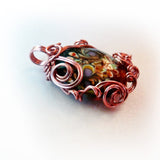 Floral lampworked glass w swirl copper wire wrap pendant