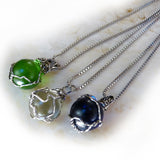 3 handmade silver wire wrapped marble pendants