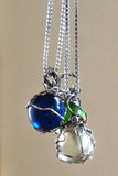 Boho chic silver wire wrapped blue glass marble pendant