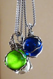 Handmade silver wire wrapped blue glass marble pendant