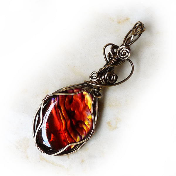 Bronze wire wrap with orange paua shell by Rhonda Chase