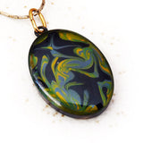 Green and black hand painted pendant by Rhonda Chase