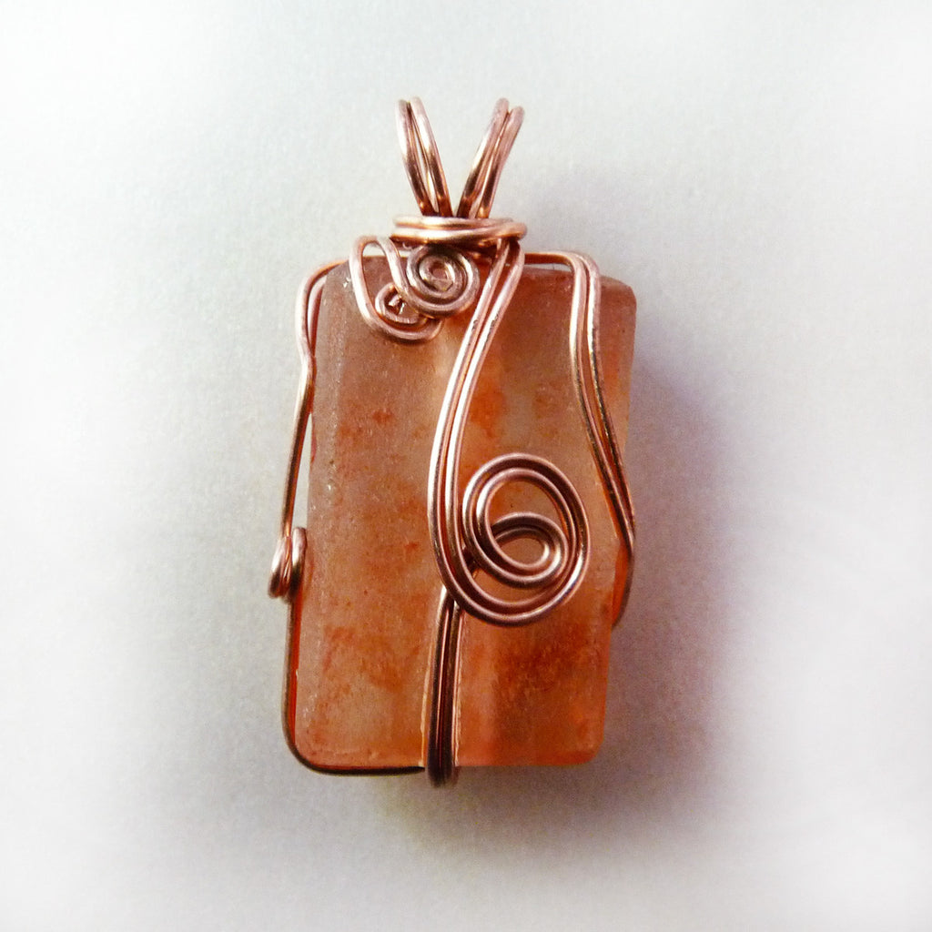 Wire wrapped recycled glass pendant Flynn Recycled Bottle Glass Beautifully Wire Wrapped Bright Copper Rhonda Chase Design Orange Recycled Glass Copper Wire Wrapped Pendant Rhonda Chase