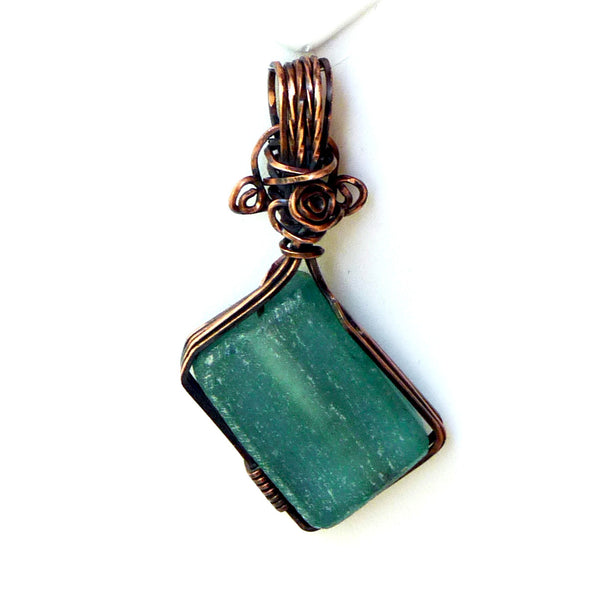 recycled bottle glass beautifully wire wrapped in copper