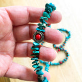 Hand holding Genuine Turquoise, Green and Red, Beautiful Beaded Necklace