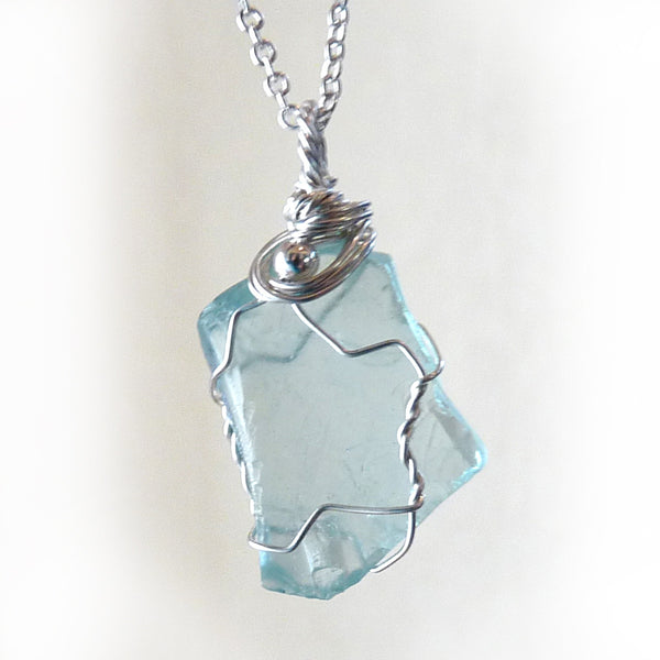 Aqua teal blue wire wrapped real sea glass in sterling silver