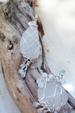 sea glass pendants on driftwood clear white sterling silver