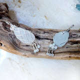 sea glass OOAK pendant necklaces on driftwood
