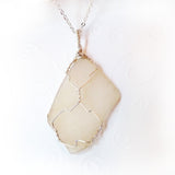 handmade wire wrapped natural sea glass in sterling silver