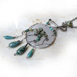 Sterling silver & turquoise wire wrapped pendant necklace