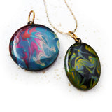 Black and green hand painted pendant by Rhonda Chase