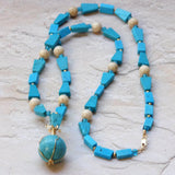 blue chalk turquoise necklace with sphere, gold filled wire