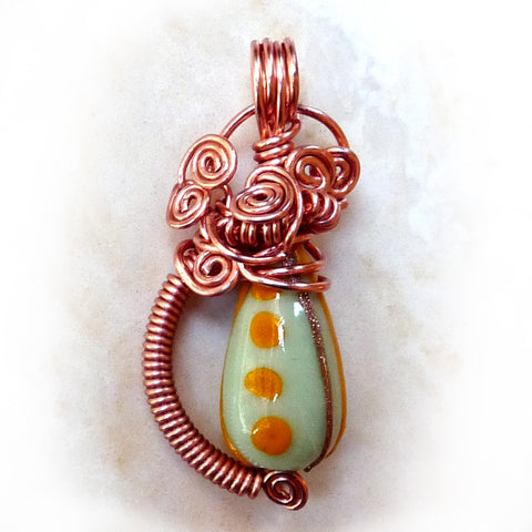 Antique green Chinese bead & copper wire wrap pendant