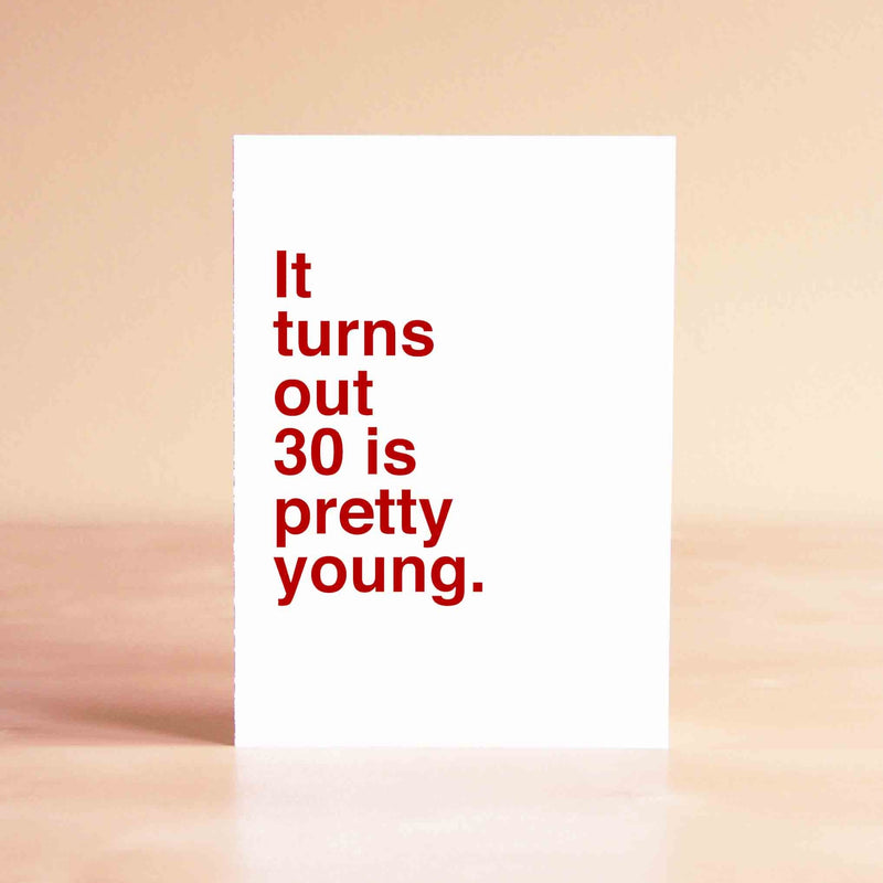 "White card with red lettering reading ""It turns out 30 is pretty young."""