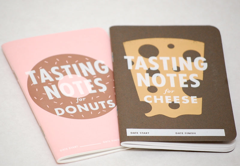 Covers of donut and cheese tasting notebooks