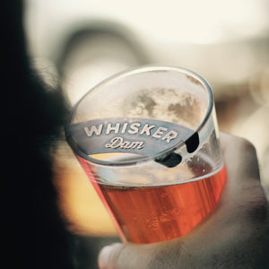 whisker dam protects mustache from beer