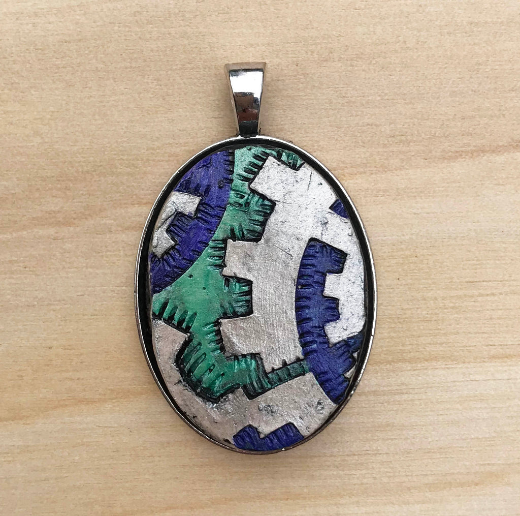 Necklace Pendant Made from Ceramic in a Silver Colored Bezel