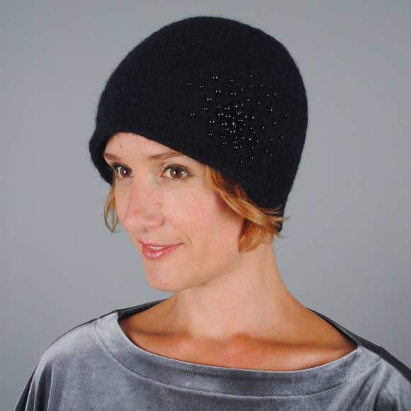 Model of a handmade pearled wool hat in black. Handmade by Julie Sinden Handmade.