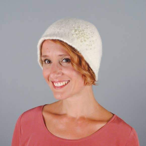 Model of a handmade pearled wool hat in white. Handmade by Julie Sinden Handmade.