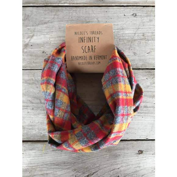 Photo of a grey, red, and mustard plaid infinity scarf handmade by Nicole's Threads.
