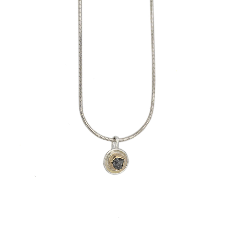 "Mini Grey rough Diamond Pendant with an 18k yellow gold bezel mounted on a .25"" silver disk 16"" sterling silver chain shot on white background"