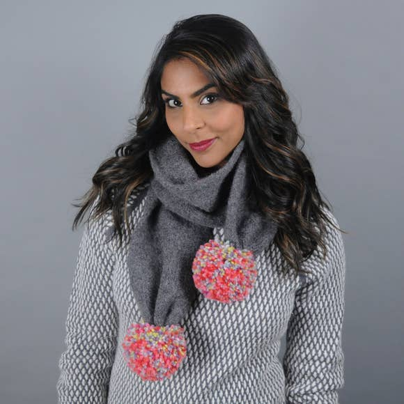 Secondary Model of a Dark Grey Scarf with Giant Multi-Colored Poms.