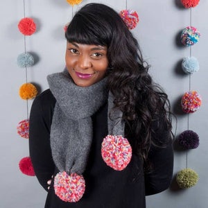 Model of a Dark Grey Scarf with Giant Multi-Colored Poms.