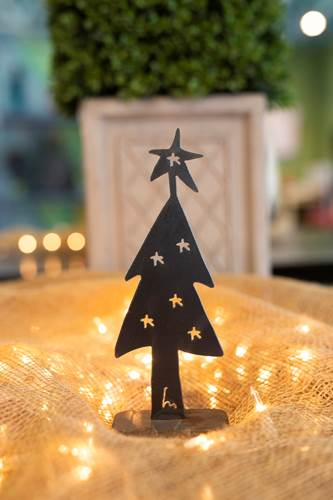 Metal Christmas Tree Sculpture decorated with cut out stars