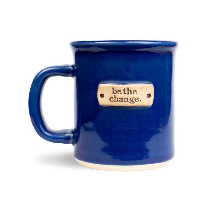 be the change stamped on a wheel thrown ultramarine blue mug