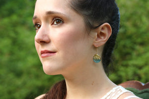 tear drop earrings on model