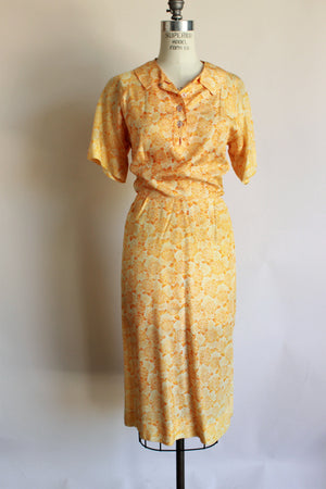 Vintage 1950s Day Dress in an Orange Abstract Floral