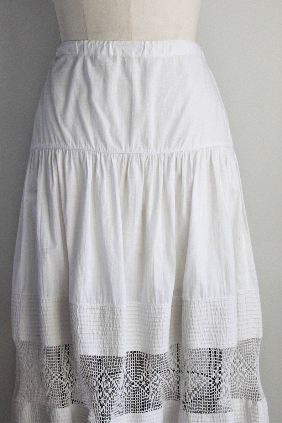 Beautiful white cotton Victorian/Edwardian petticoat. Loose Crochet scalloped edge hem with pintuck ruffles in a two layers. Drawstring waist so its really a flexible, comfortable fit. Would make a great boho skirt