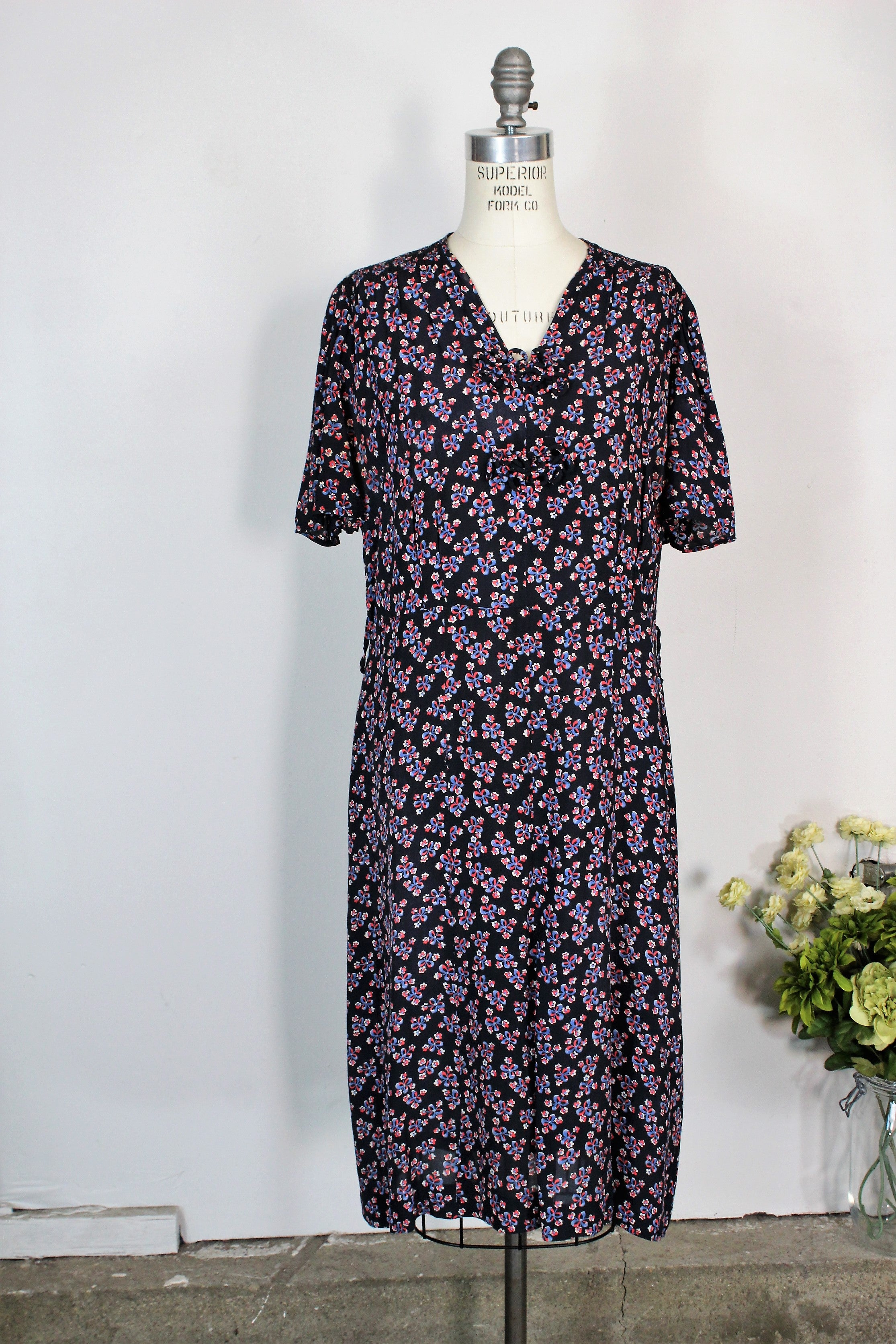 Vintage 1940s Rayon Day Dress With A Floral And Bow Print In Red White And Blue