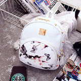 Urban Edgy Rivet Floral Print Backpack