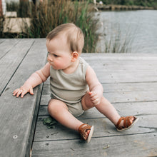 baby boy fashion wearing neutral onesie and tan leather Tikitot prewalker sandals