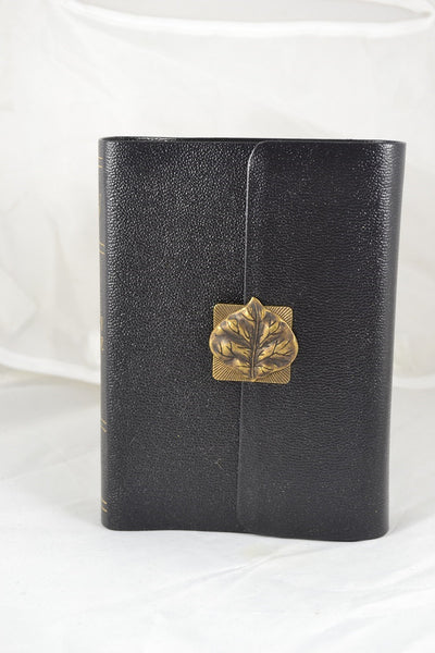 KJV Compact Bible, Large Print, Black w/magnetic flap Turning over a leaf