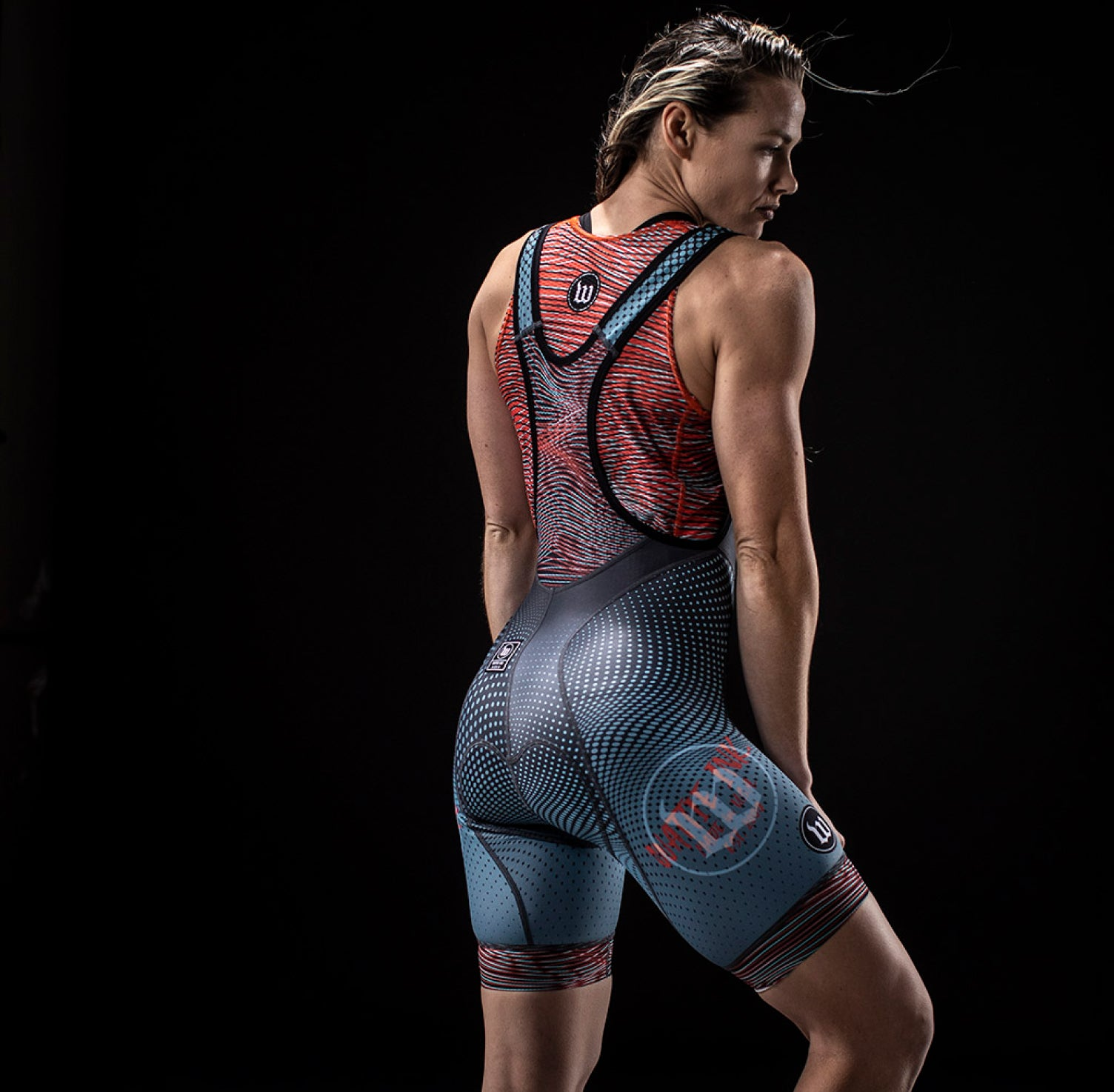 women in cycling suit in her back