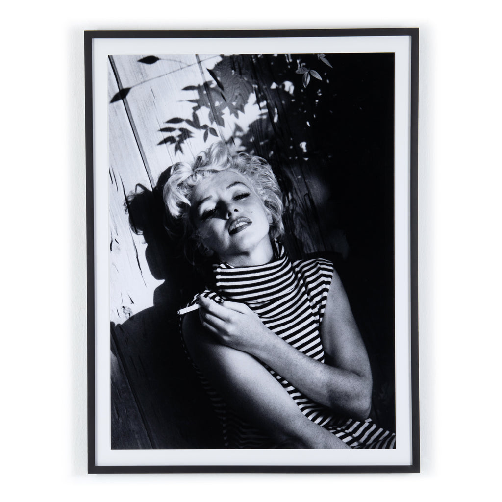 Marilyn Monroe Relaxing Framed Wall Art by Getty Images
