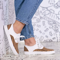 The Corky canvas sneakers for women feature memory foam insoles and rubber soles for comfort.