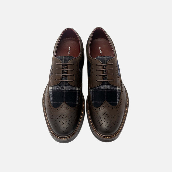 The August brown wingtip shoes have both calfskin leather and merino wool for warmth and comfort.