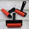 Lightweight handy plastic handled rubber roller.