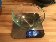 A food scale to weigh backpacking meal before and after dehydrating