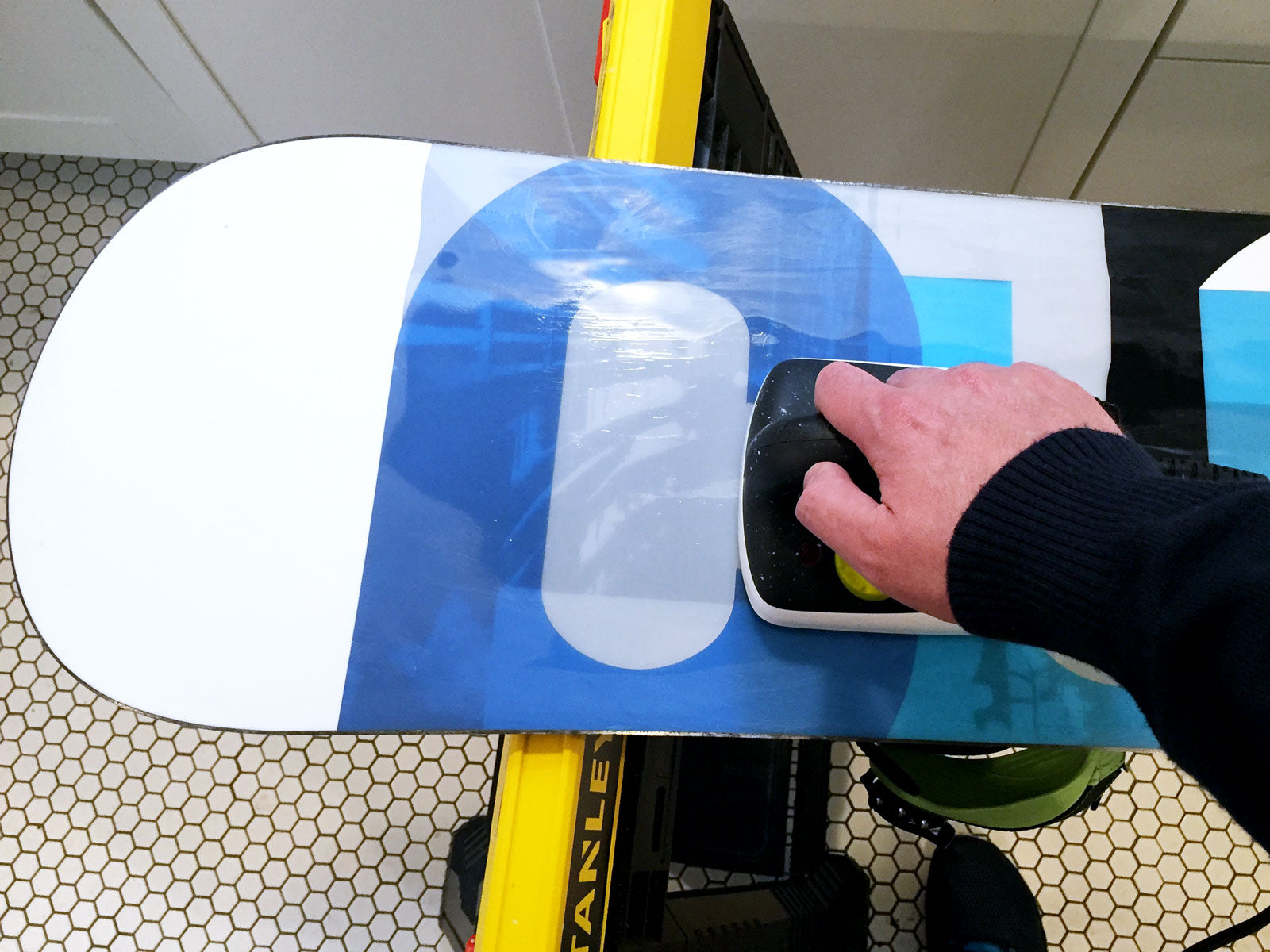Using a wax iron to wax a snowboard
