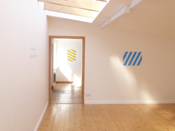 SOME DIAGONAL LINES TO BRIGHTEN A DESIGNATED SPACE by Thomas A. Clark + David Bellingham