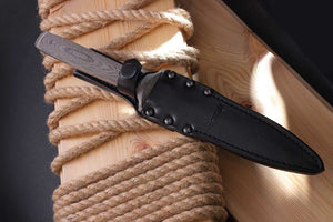 Sting- dagger by N.C. Custom in the sheath